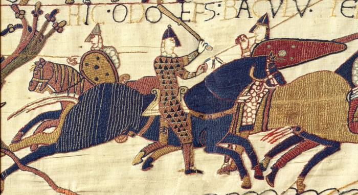 detail of the bayeux tapestry - two knights on horseback fighting